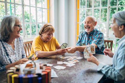 group of elders playing card game