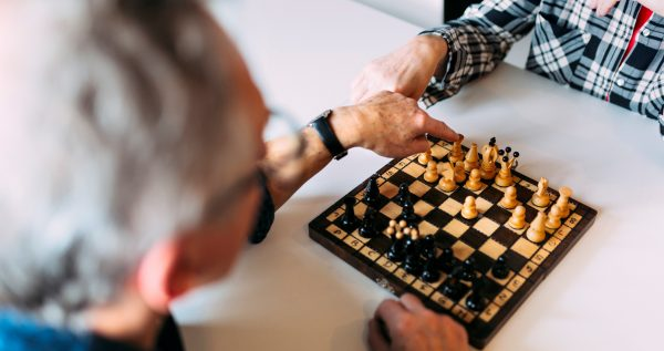Two people playing chess